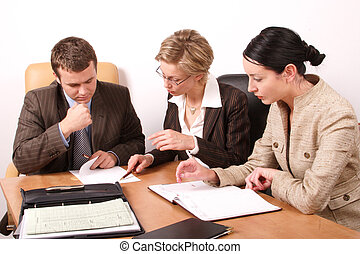 Group of business people working at the desk