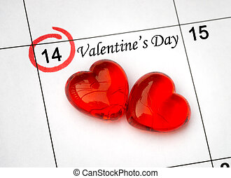 Calendar page with the red hearts on February 14 of Saint Valentines day.