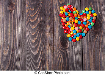 Candy Hearts on wood , valentines day background