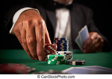 card player gambling casino chips on green felt background selective focus