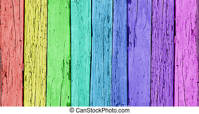Colorful wood background with a vertical wooden row of rainbow colors.