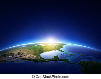 Earth sunrise over cloudless North America (Elements of this image furnished by NASA)