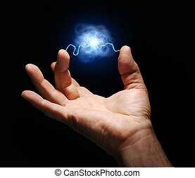 male hand with electricity arcing between thumb and middle finger with plasma ball suspended in the center