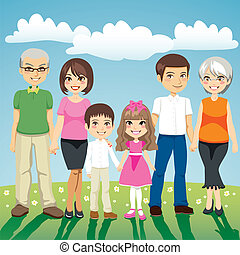 Portrait of six people extended family standing outdoors holding hands