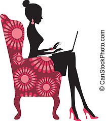 Young fashionable woman working on laptop computer