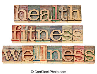 health, fitness, wellness - healthy lifestyle concept - isolated text in vintage letterpress wood type