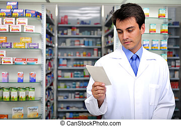 hispanic pharmacist reading prescription at pharmacy
