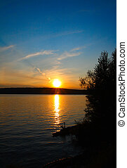 lake landscape in dusk with sunset