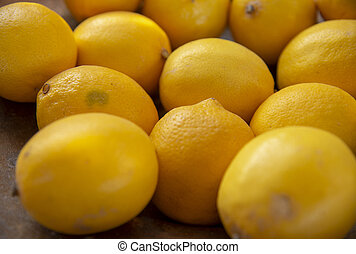 Lemon background. Selective focus. yellow fruits are stacked side by side.