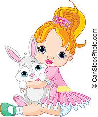 Cute little girl hugging toy bunny