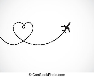 Love Travel Concept - A Airplane flying in the dark blue sky leaving behind a love shaped smoke trail