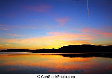 morning lake with mountain before sunrise