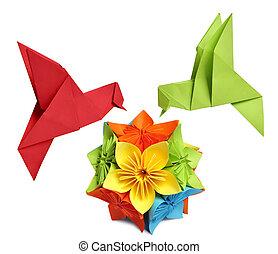 origami humming-bird over flower kusudama over white background