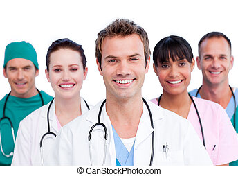 Portrait of a smiling medical team against a white background