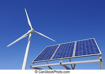 windmill and solar panel with a clear blue sky