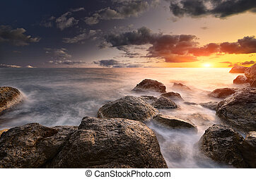 Rocks and sea. Dramatic scene. Composition of nature.