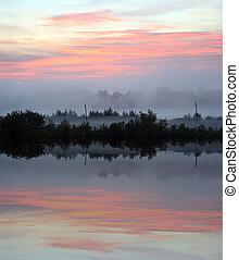 mist landscape with sunrise over lake