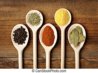 collection of various food ingredients in wooden spoons