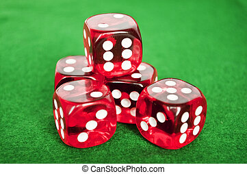 Set of gambling dices on green background