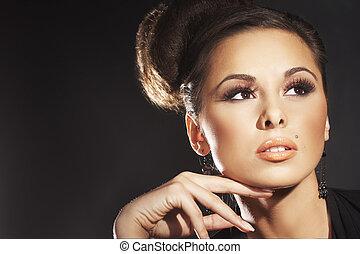sexy fashion model posing on black background