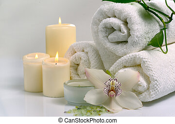 spa concept with orchid flower and burn candles