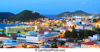 Virgin Islands St Thomas mountain panorama view in early morning with buildings and beach coastline.