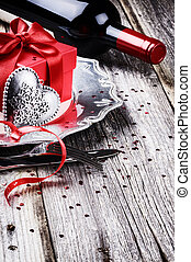 St Valentine's table setting with present and red wine