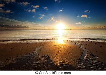 Sunrise sea beach sky landscape. Beautiful sun light reflection in ocean water nature background
