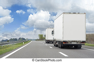 HDR image of two trucks in transportation route
