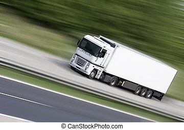 White truck on highway (blur background) - transportation