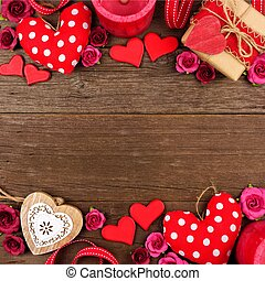 Valentines Day double border of hearts, gifts, flowers and decor on rustic wood