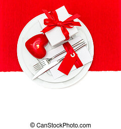 Valentines Day table place setting in Red and White with candle