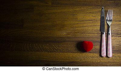 Valentines day table place setting with red present Wooden table with copy space