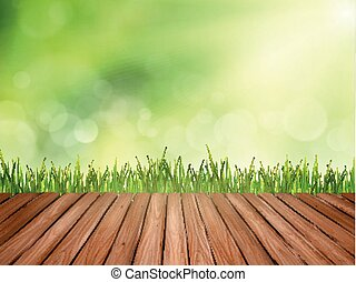 green abstract blurred nature background with wooden table and grass