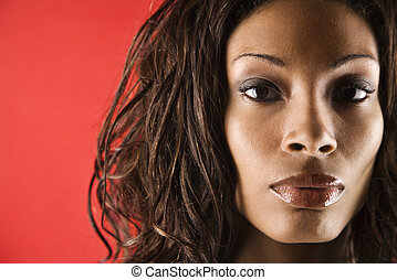 Young adult African American female face close up.